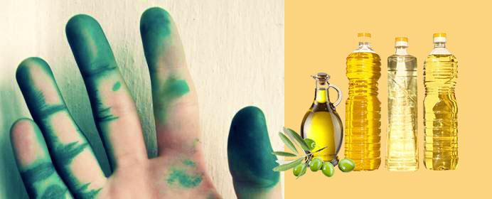 Рука в зеленке и масла растительные