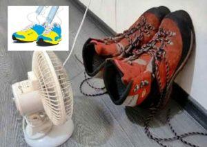 Красные кроссовки сохнут перед вентилятором